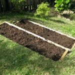 DIY Terrace Garden Bed - By simply reshaping the sloped ground into stepped raised beds you're creating a system where rainwater soaks into the soil rather rolling down it which prevents erosion.