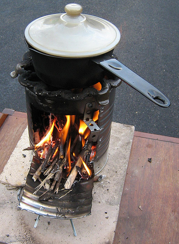 Survival Basics: How to Build a Fire in a Rocket Stove - One of those skills that every prepper needs is the ability to cook food outdoors. Sure, we all know how to fire up the barbie and grill burgers.  But what if the backyard barbecue was not available?