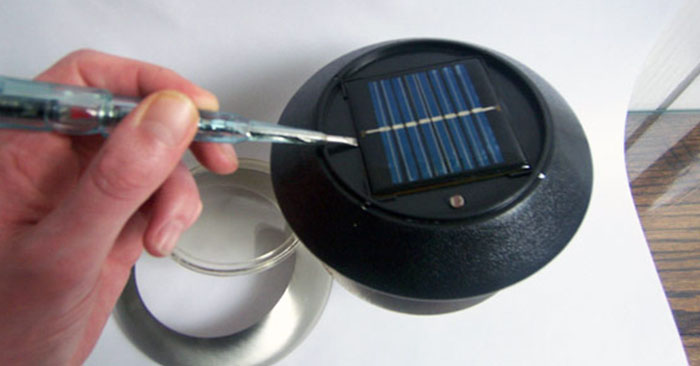 DIY $3 Solar Powered Small Electronic USB Charger - The cool thing about this little project is you can keep the charger in the sun during the day and at night plug it in and it will charge your devices from the batteries already in the solar device.