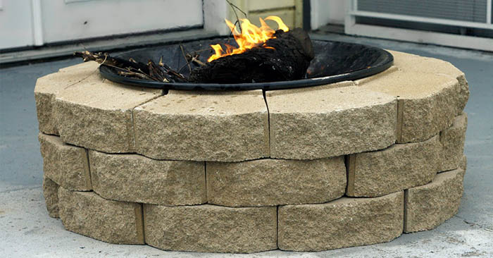 DIY Brick Fire Pit on a Budget - This project is easy to make and because its made of brick it is a sturdy pit. You will have no worries about looters stealing the metal one.