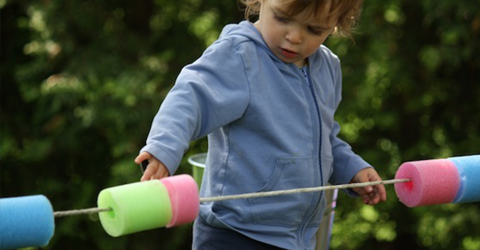 18 Simple, Super-Cool and FREE (or almost free) Features to Add to Your Backyard Play Space - Do you have a bunch of older Tupperware and maybe some hose? Make a water wall for those hot sunny days and let the kids have at it.