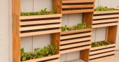 """How To Make a Space-Saving Vertical Vegetable Garden - You can get the equipment needed to start a vertical garden pretty cheap or even free if you check out Craigslist to see if someone is getting rid of pallets or wood. If you use pallets, make sure to look for """"HT"""" which means it's heat treated for vermin rather than with harsh chemicals."""