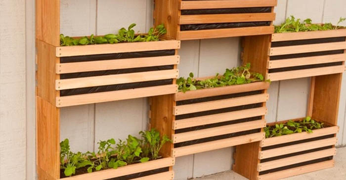 "How To Make a Space-Saving Vertical Vegetable Garden - You can get the equipment needed to start a vertical garden pretty cheap or even free if you check out Craigslist to see if someone is getting rid of pallets or wood. If you use pallets, make sure to look for ""HT"" which means it's heat treated for vermin rather than with harsh chemicals."