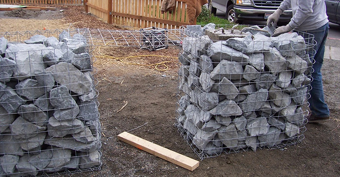 DIY Fence Posts With No Digging - Knowing how to put in fence posts with no digging is a great homesteading skill you may want to know in case you need to put up a fence in hard clay or rocky and tree root infested ground.