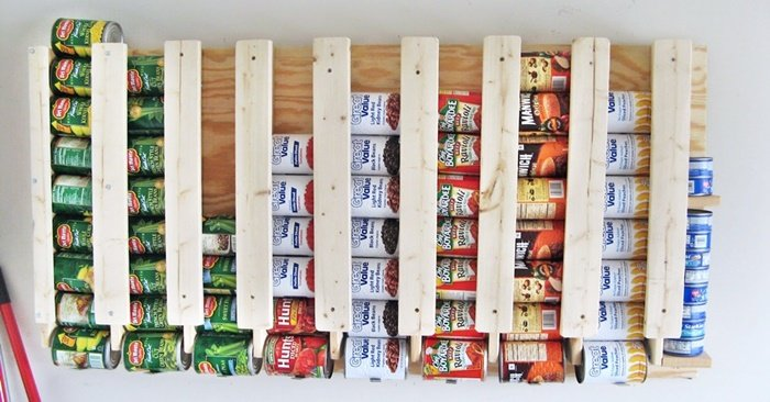 How To Build A Rotating Canned Food Storage System - This DIY project has to be by far the easiest and most clever way to build canned storage! If you have been looking for a way to store your canned food that takes up less space than just putting them on a shelf this project is for you.