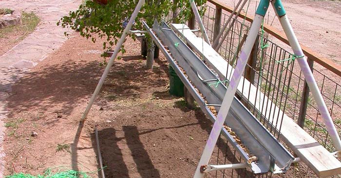 How To Build A Double Decker Greenhouse Garden — This project is great for a garden in a small space for a short season. This instructable shows you how to Recycle an old swing set into a green house.