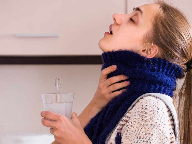 Woman gargling with salt water