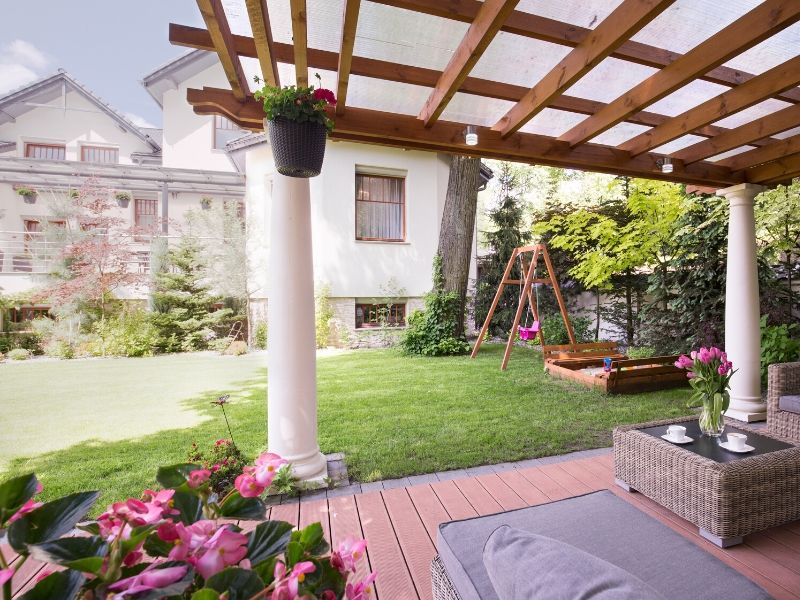Outdoor furniture under a pergola