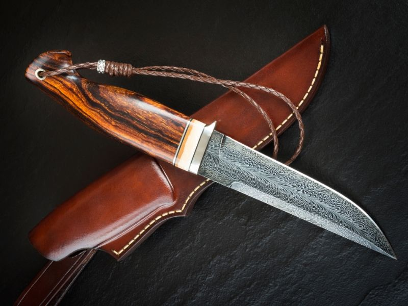 Survival knife with brown cover