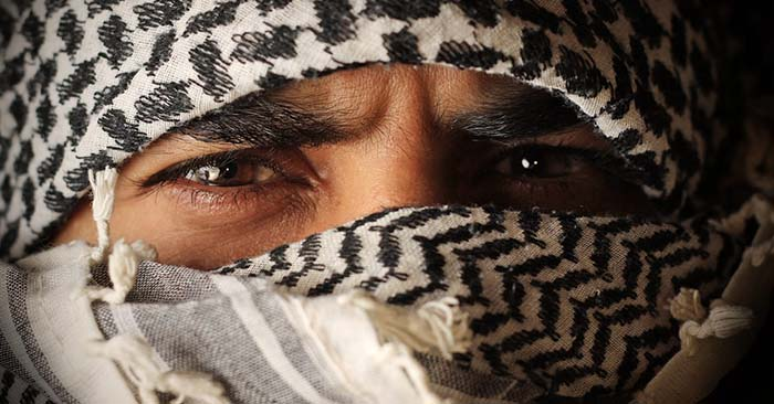 man with a shemagh covering his face