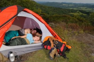 Young couple sleeping in a tent