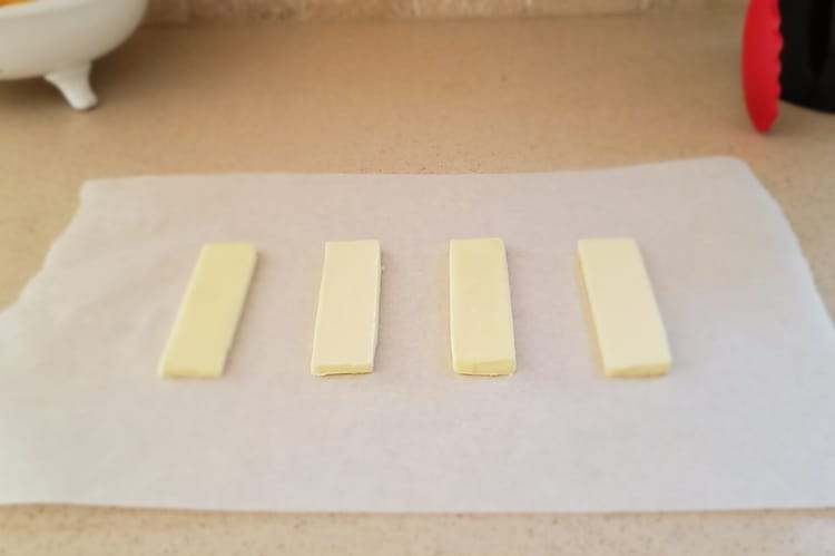 stick of butter sliced horizontally into slabs