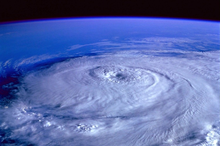 In the event of a hurricane, retrieve your hurricane preparedness kit, secure your windows, doors and roof, stock up on supplies, and shelter in an interior room of the house.