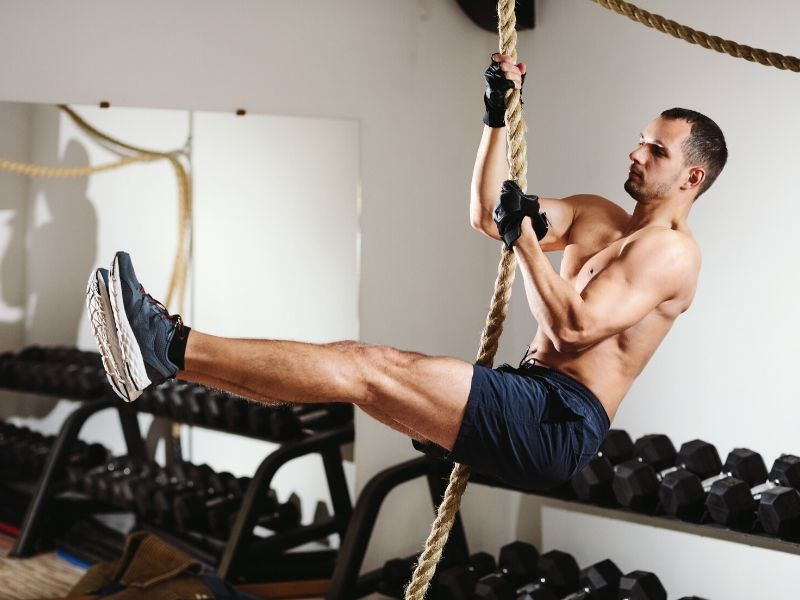 Guy exercising with a rope