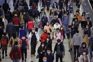crowd wearing face masks to protect from COVID-19 coronavirus