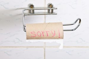 "an empty toilet paper roll with the words ""sorry!"" on the roll"