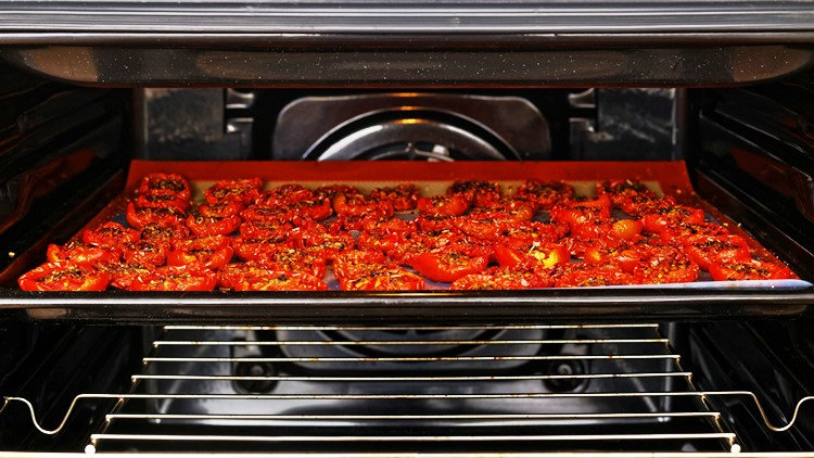 tomatoes drying in an oven