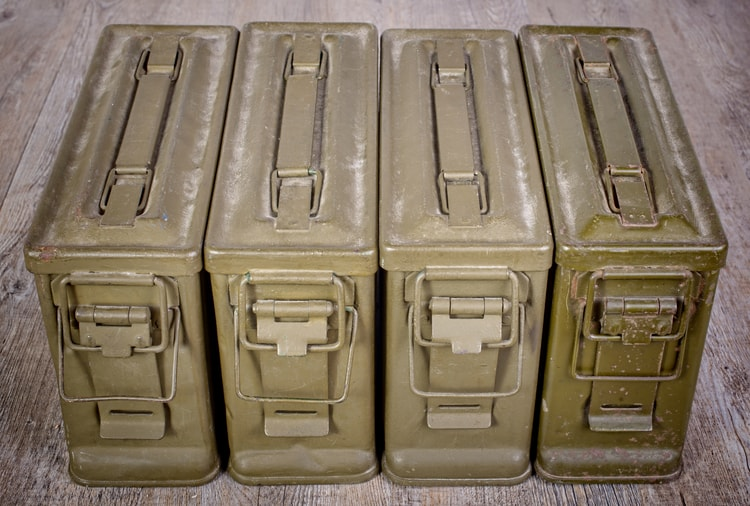 4 ammo cans lined up for storage